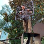 picture of Earl Dismuke with a metal sculpture.