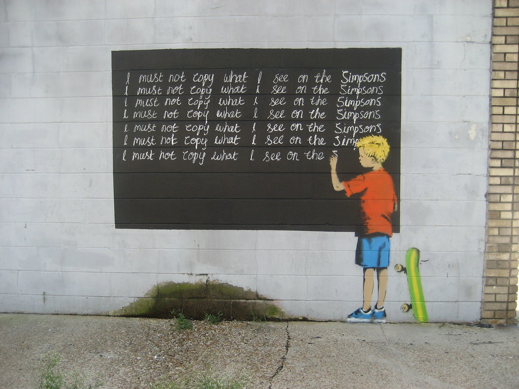 mural by Banksy showing a boy writing lines on a chalkboard: I must not copy what I see on the Simpsons