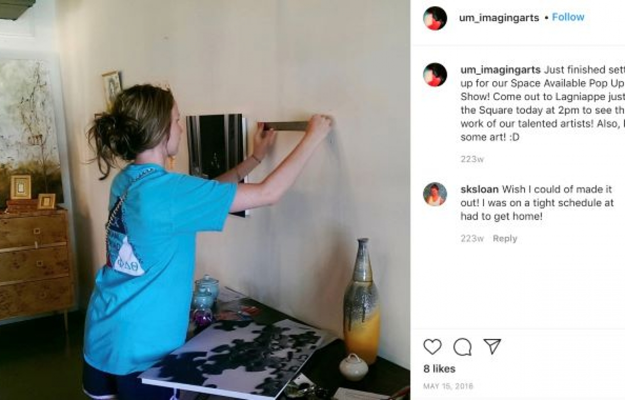 Clicks Instagram post featuring woman setting up the space for a Pop Up Show.