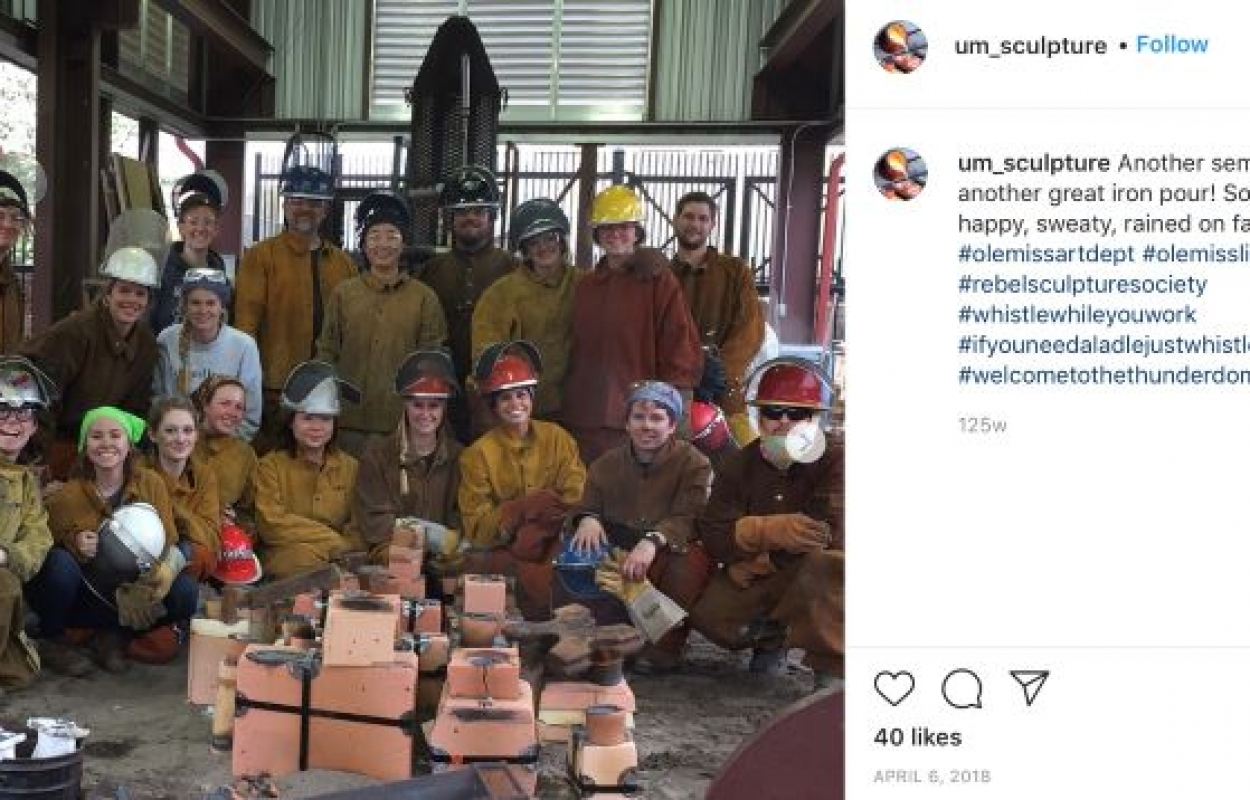Sculpture Instagram post featuring faculty and students posing after an iron pour.