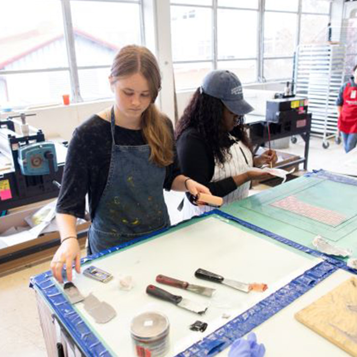 A student works in a printmaking studio.