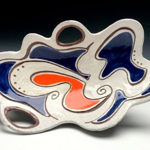 A colorful, abstract, ceramic plate