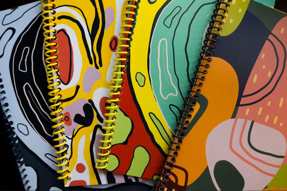 Graphic design student final work of colorful notebook covers