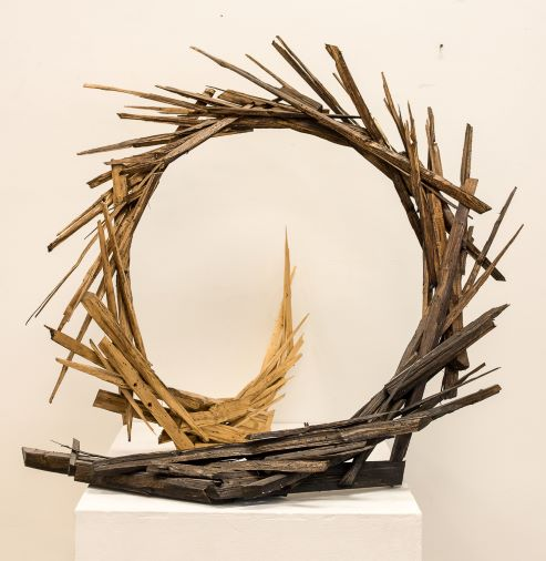 Scultpure of wooden sticks formed into an upright circle