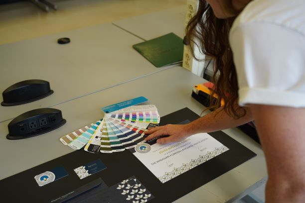 Student selects the correct color from a fan deck for her design project.