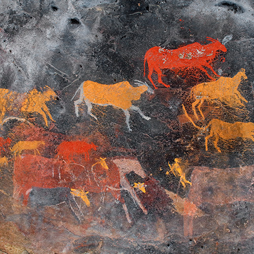 South African cave art painting of antelopes and a hunter with bow and arrow.