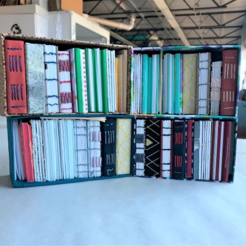 Photo of a collection of handmade books created in Art 373, Book Arts